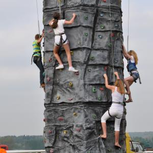 Mobile climbing wall available for team building events, corporate family days and outdoor events
