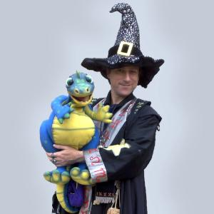 Wizard with dragon puppet