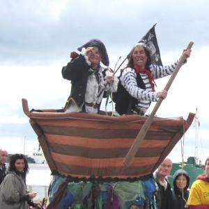 Pirates in a boat street theatre act