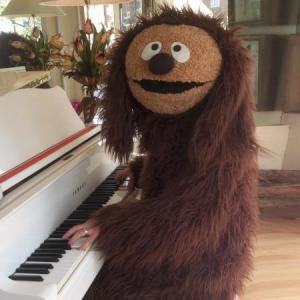 Rowlf, the famous piano playing dog street theatre act