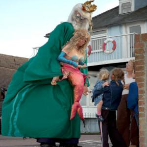 Mermaid and Neptune strolling street theatre act.