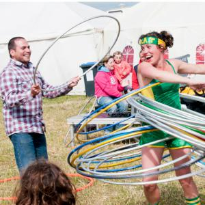 Olympic themed hula hooping act