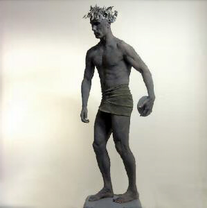 Classical olympic discus thrower human statue