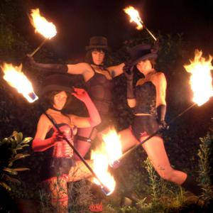 Three female artistes in fire act